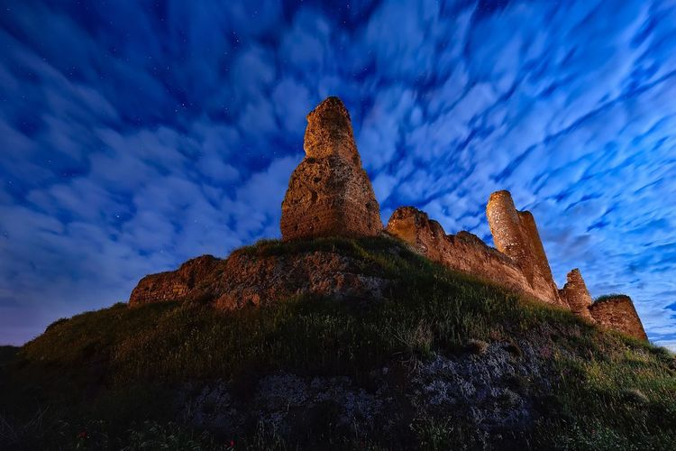 Castle at cloudysky Cloud - Sky Sky Mountain Nature No People Outdoors Night Cloudy Sky Clouds Abandoned Built Structure Architecture Medieval Nightphotography Night Photography Dramatic Sky Castle Cloud Cloudy Colour Your Horizn