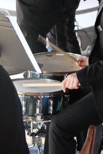 The drummer plays on Drums Real People Music Occupation Human Hand Men Musical Instrument Arts Culture And Entertainment Hand People Human Body Part Musical Equipment Skill  Midsection Indoors  Playing Working
