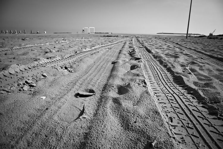 View of tire tracks on beach