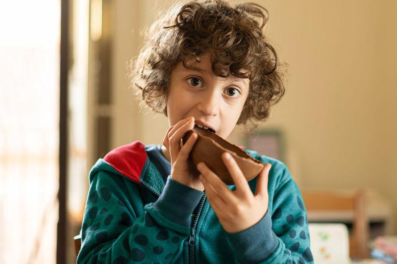 Children eating chocolate easter egg