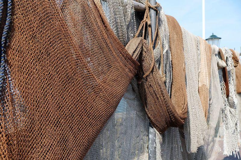 Close-up of fishnets at harbor