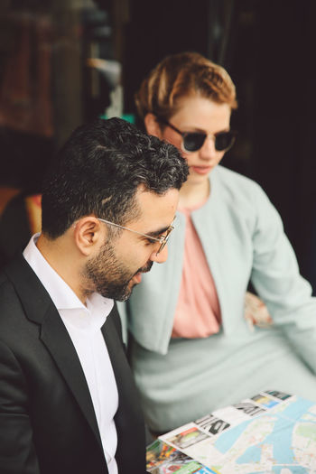 Beard Businessman Cultures Day Fashion Friendship Indoors  Lifestyles Men Mid Adult Mid Adult Men People Photoshoot Real People Rotterdam Sitting Sunglasses Togetherness Two People Young Adult Young Men Fashion Stories