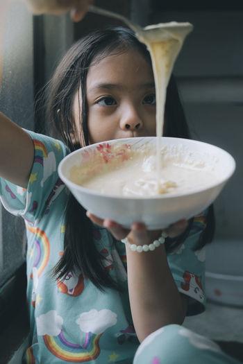 Portrait of girl ready for baking