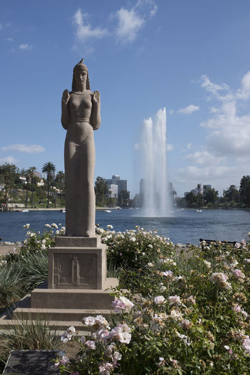 Bird on the Head of a Statue Guarding Echo Park Lake Echo Park  Echo Park Lake Los Angeles, California Beauty In Nature Bird Cloud - Sky Day Flower Fountain Growth Motion Nature No People Outdoors Park Plant Scenics Sculpture Sky Spraying Statue Tree Water