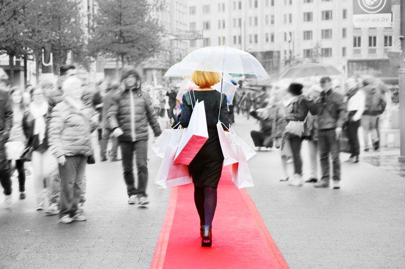 Belgium Blurred Motion City Life Full Length Lifestyles Meir Protection Real People Shopping Shopping Street Umbrella Walking Women