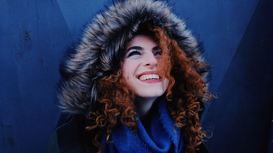 Smiling Young Woman Wearing Fur Coat