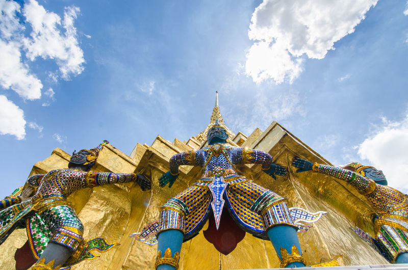 Wat Phra Kaew Architectural Feature Architecture Blue Built Structure Capital Cities  Cloud Cloud - Sky Cloudy Cultures Famous Place Grand Palace Bangkok Thailand Low Angle View No People Ornate Outdoors Place Of Worship Sky Spirituality Temple - Building Thailand Tourism Travel Destinations Wat Phra Kaew