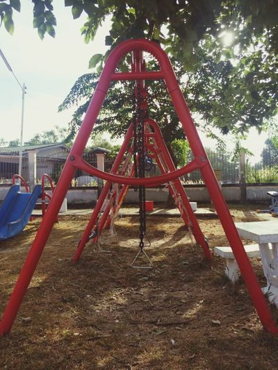 Not people Playground Tree Outdoor Play Equipment Childhood Monkey Bars Park - Man Made Space Slide - Play Equipment Hanging Metal Jungle Gym Outdoors Day Nature Swing No People Sky