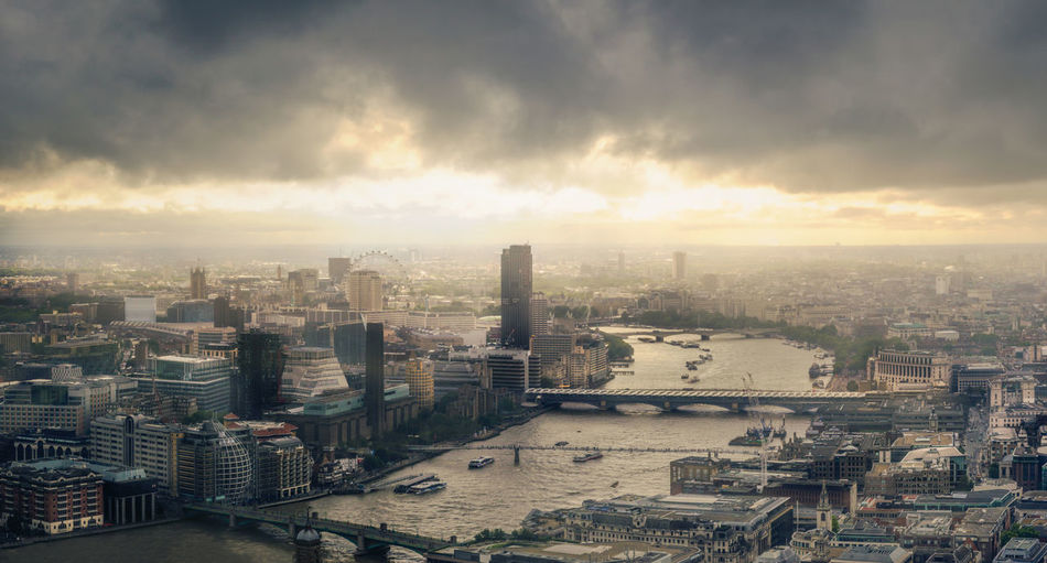 A picture taken from the top of the walkie talkie in the city of london, overlooking the west of the city at sunset. Aerial View Architecture Building Exterior Business Finance And Industry City City Life Cityscape Cloud - Sky Day Downtown District Horizontal London Modern No People Office Building Exterior Outdoors Sky Skyscraper Sunset Travel Destinations Urban Skyline