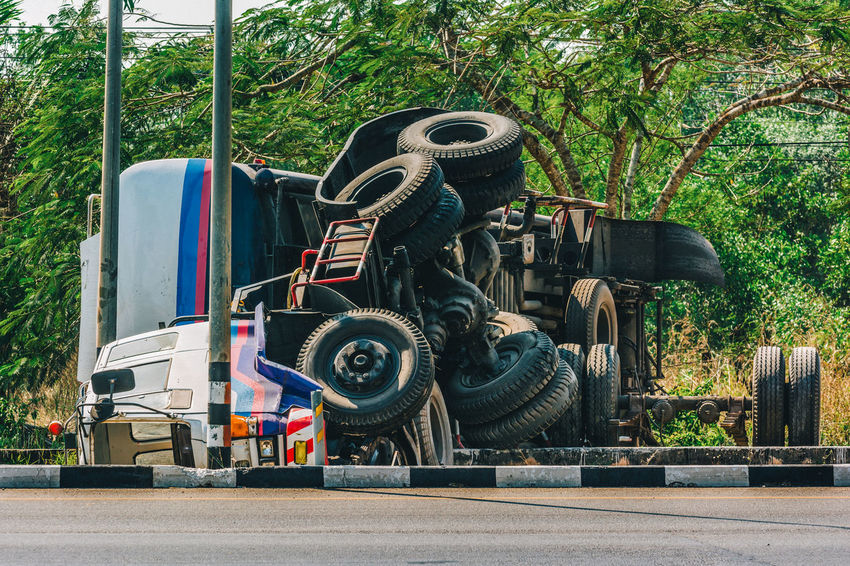 Accident Calamity Crash Dangerous Down Highway Machinery Mishap Overturned Road Tire Transportation Transportation Tree Truck Upside Vehicle