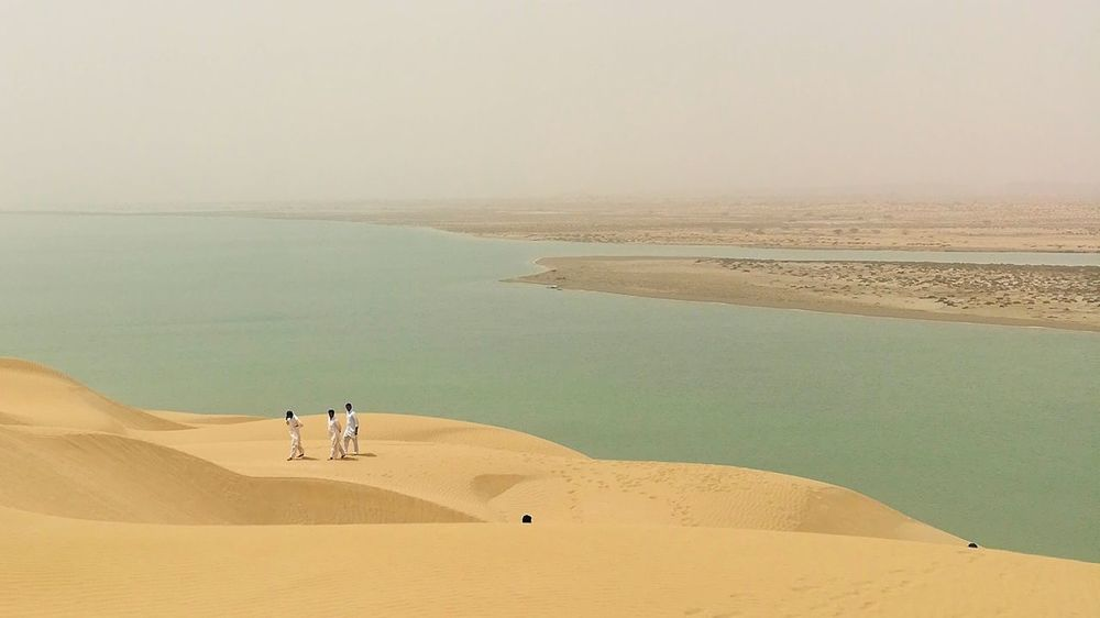 EyeEm Best Shots EyeEmNewHere EyeEm Selects Sand Dune Desert Sea Clear Sky Men Sand Water Full Length Beach Sky