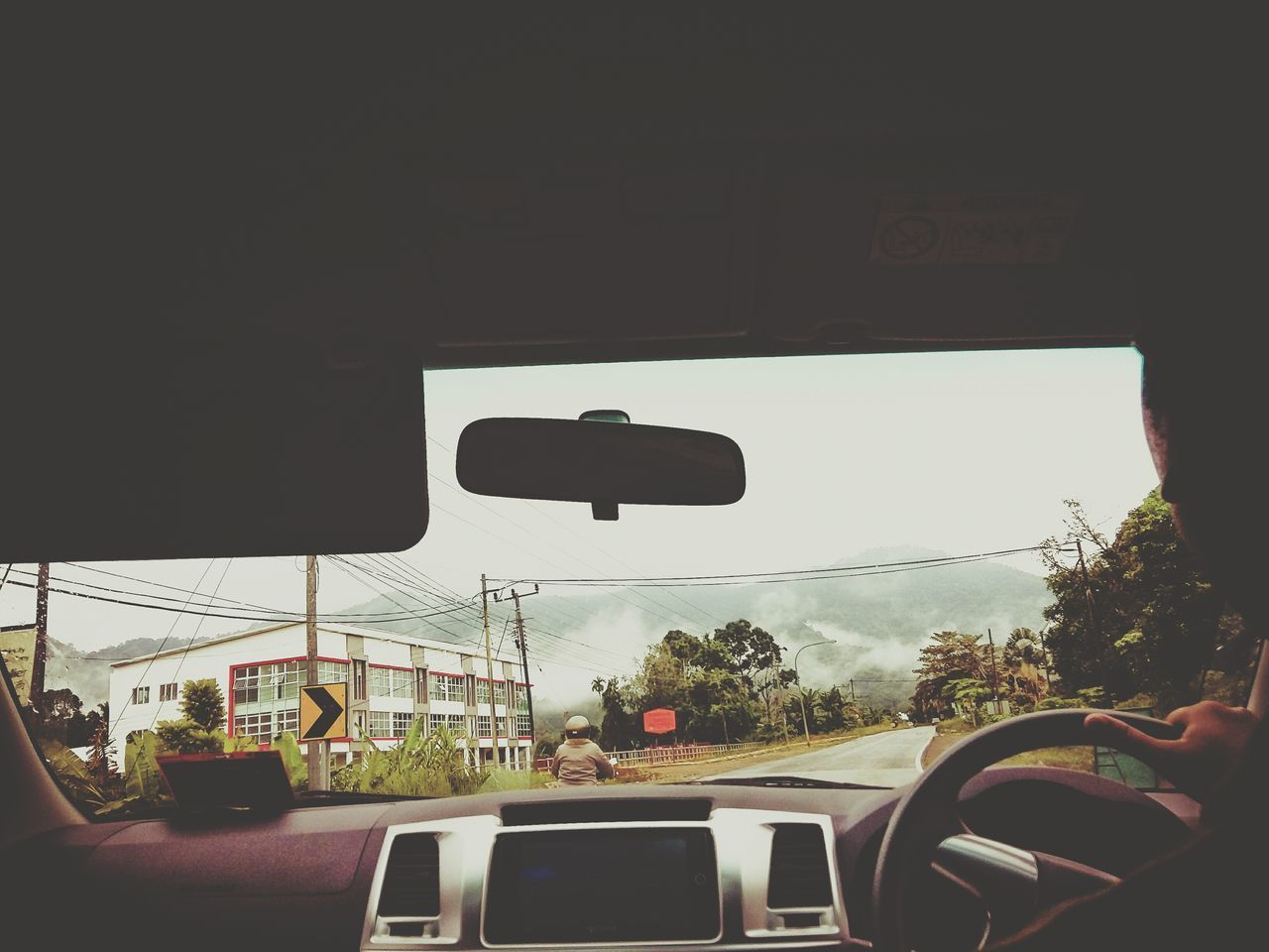 car, transportation, mode of transport, land vehicle, vehicle interior, car interior, windshield, driving, day, journey, road trip, real people, tree, travel, road, one person, steering wheel, car point of view, sky, men, human hand, outdoors, nature, people