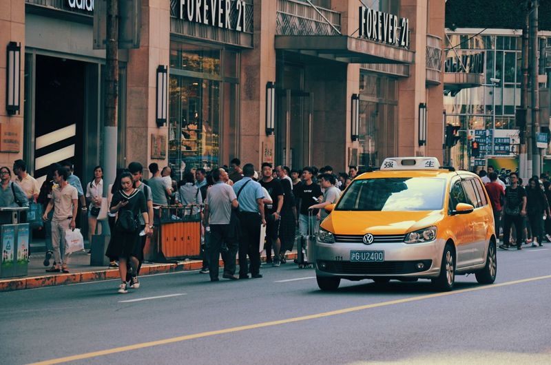 Car Large Group Of People City Street Yellow Taxi City People Police Force Adults Only Outdoors Architecture Adult Day Crowd Street Photography Streetphotography