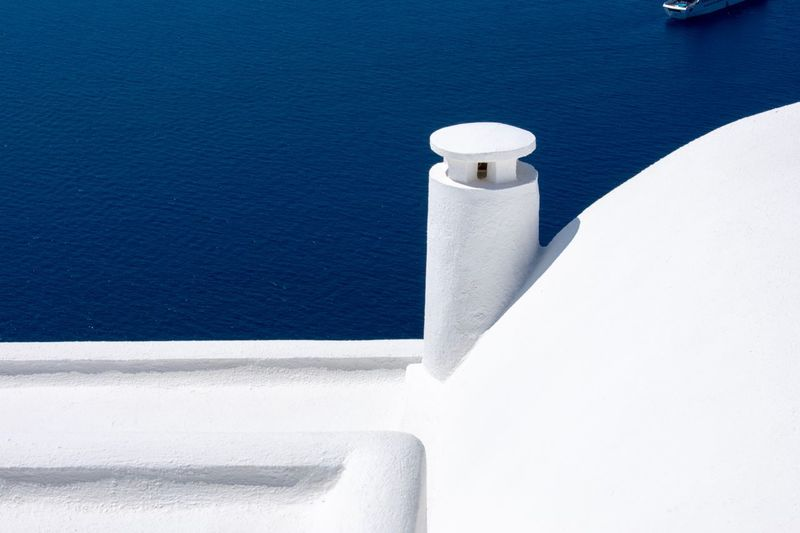 Imerovigli Minimalism Santorini EyEmNewHere EyeEm Selects White Color Water No People Sunlight Sea Whitewashed Wall - Building Feature Nature Day Architecture Built Structure Outdoors Shadow Building Exterior Close-up Copy Space High Angle View Blue Wall