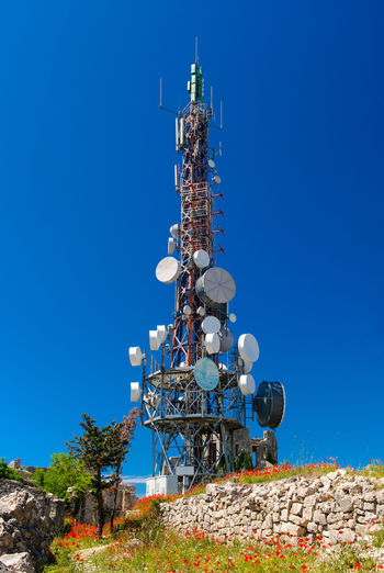 Low Angle View Of Television Tower Against Blue Sky