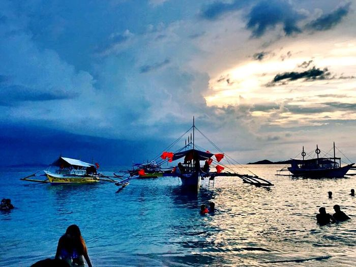 The calm and the storm in one scene Nautical Vessel Sky Transportation Water Cloud - Sky Mode Of Transport Sea Nature Scenics Beauty In Nature Outdoors Tranquility Moored Real People Men Day Horizon Over Water Beach Outrigger Calmin The East Storm In The West