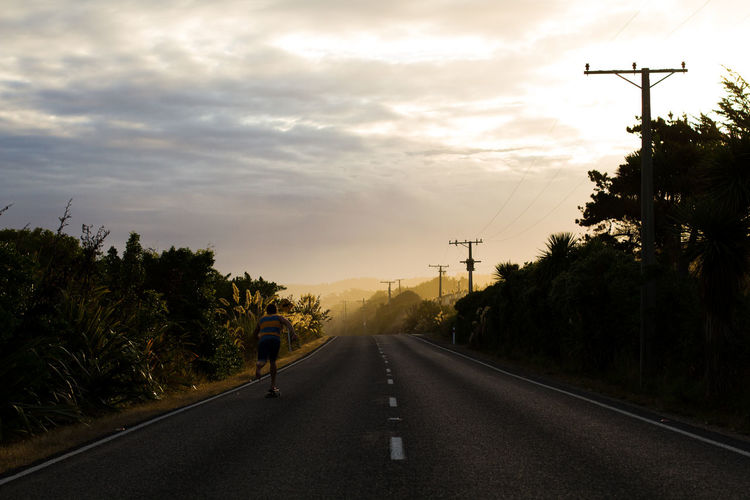 Skating on the backroads of Dunedin, New Zealand. Highway Journey New Zealand Road Skate Skateboarding Sky Sunset