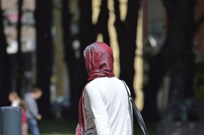 Woman in headscarf walking outdoors