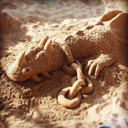 Sunbathing dragon! Sand Sculpture Helptheheroes Goodcause charity art beach dayout holiday morecambe morecambebay morecambebeach promanade sunny summer