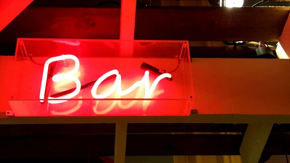Red Text Neon Communication Illuminated Nightlife Lighting Equipment Night Architecture City Low Angle View No People Indoors  Bar Bar Sign