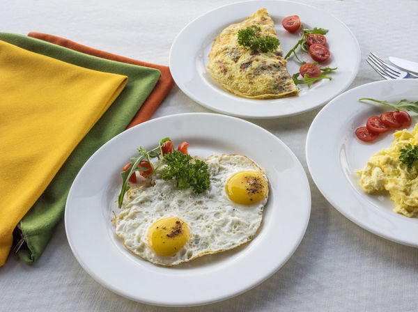 Omelets and frying eggs on the table Breakfast Frying Breakfast Close-up Day Egg Egg Yolk Eggs Food Food And Drink Freshness Fried Egg Healthy Eating High Angle View Indoors  No People Omelet Plate Ready-to-eat Serving Size Table Yellow Yolk