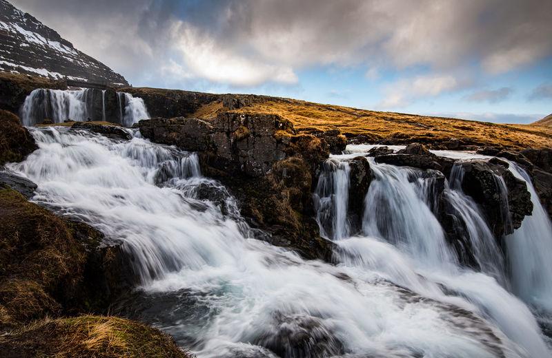 The kirkjufell mountain and the kirkjufellfoss waterfall  in iceland