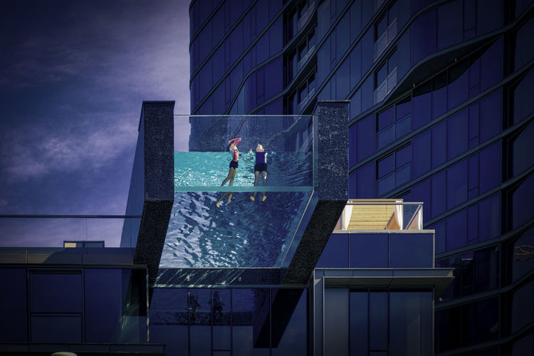 Swim in the sky Architecture Building Building Exterior Built Structure City Glass - Material Low Angle View Modern Nature Night Office Office Building Exterior Outdoors People Real People Reflection Sky Skyscraper Standing Two People Summer In The City