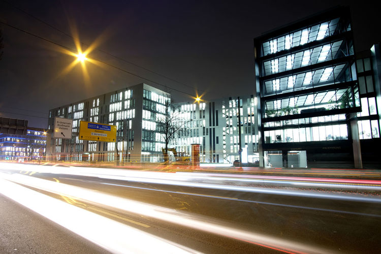 A street scene on a croudy street in Düsseldorf. Architecture Built Structure Business Finance And Industry City City Life Cityscape Igniting Long Exposure Motion Night No People Outdoors Road Sky Transportation Transportation Fujifilm_xseries FUJIFILM X-T2 The Week On Eyem