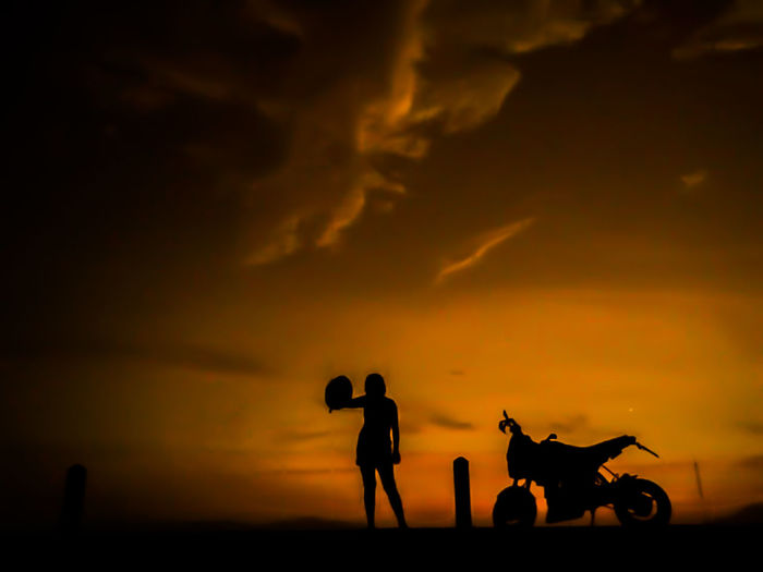 Baby Stroller Bonding Cloud - Sky Friendship Land Vehicle Landscape Leisure Activity Lifestyles Mammal Nature Outdoors Real People Riding Silhouette Sky Sunset Togetherness