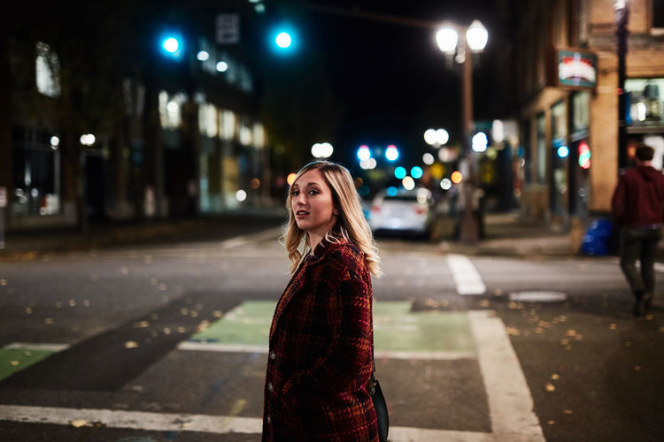 Adult Architecture Building Exterior Built Structure City Focus On Foreground Illuminated Night One Person Outdoors People Portrait Real People Street Young Adult Young Women