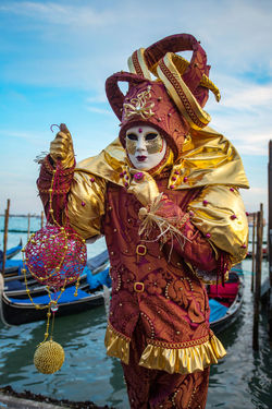 Carnival Carnival In Venice Venice, Italy Carnival Carnival Clothing Carnival Masks Cloud - Sky Costume Cultures Day Focus On Foreground Mask - Disguise Men One Person Outdoors Real People Sky Standing Tradition Traditional Clothing Venetian Mask Water