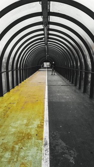 Yellow brick road. Arch Architecture Covered Bridge Footbridge Bridge - Man Made Structure Arch Bridge Bridge LINE Parallel Arched vanishing point Road Marking Diminishing Perspective Walkway The Street Photographer - 2018 EyeEm Awards