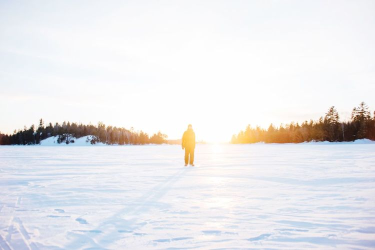 Copy Space Golden Hour EyeEm Selects Winter Snow Cold Temperature Frozen Full Length Nature Tree White Color Copy Space One Person Beauty In Nature Outdoors Warm Clothing Tranquil Scene Ski Holiday Sunlight Leisure Activity Landscape Day Scenics
