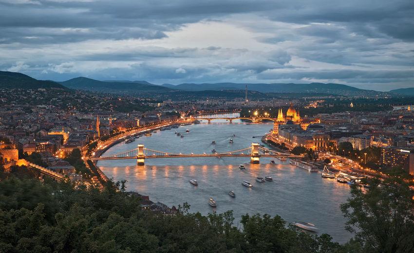 High angle view of illuminated city at riverbank
