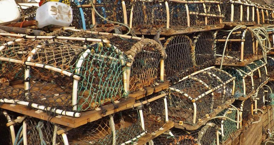 Stack Of Fishing Nets At Harbor