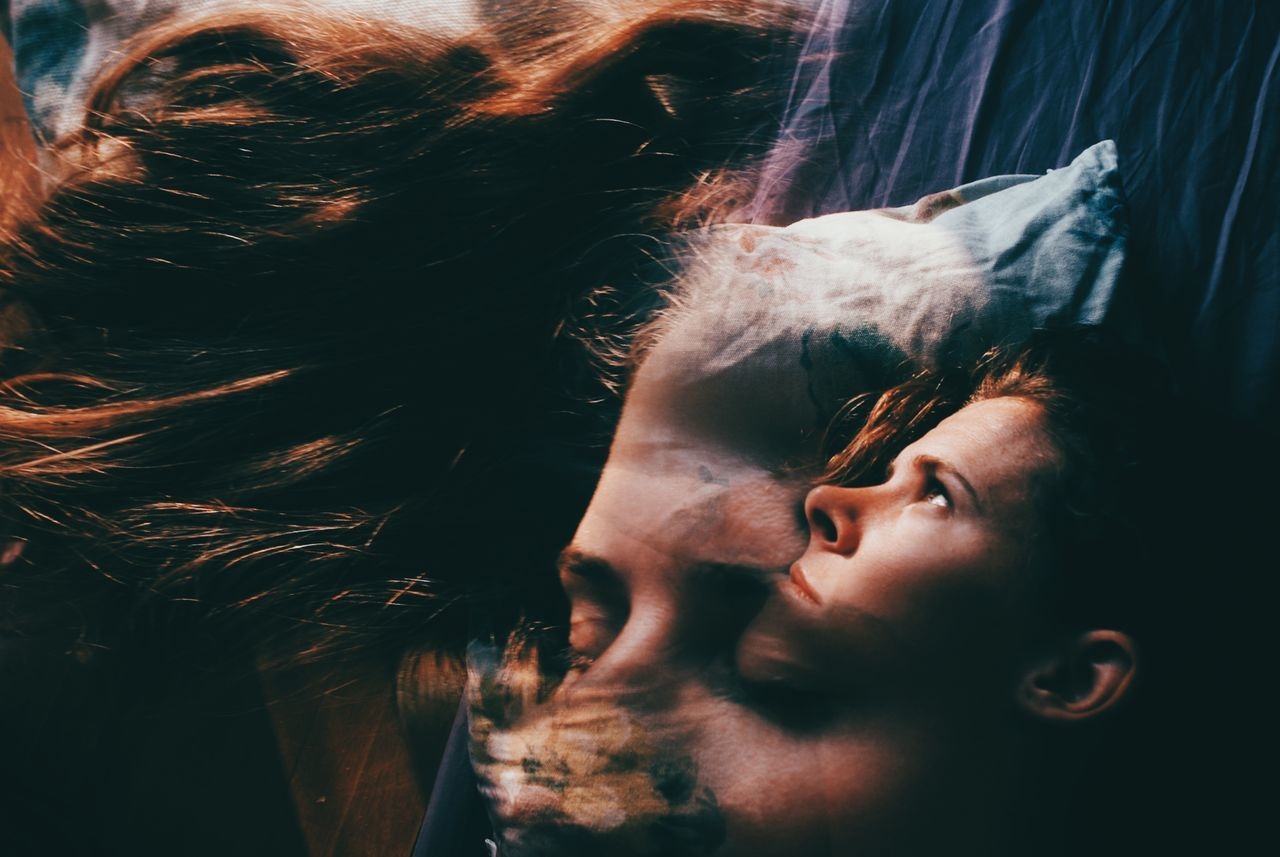 Multiple exposure of man and woman lying on bed