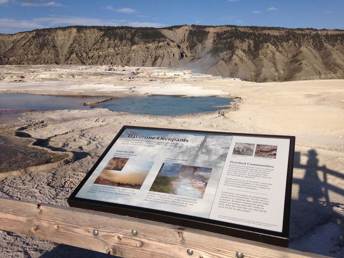 Picture Frame By Railing Against Mountain At Yellowstone National Park