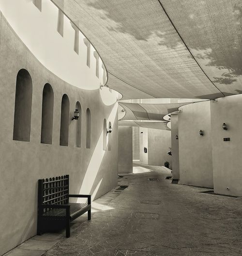 The comfort of Loneliness..! Sunlight Bliss Explore Outdoors Bwstreetphotography BW_photography Light And Shadow Qatar Katara Cultural Village Aisle Beautiful Street Architecture Built Structure Day An Eye For Travel The Graphic City