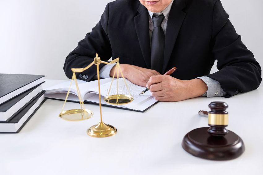Lawyer Balance Barrister Business Business Person Businessman Counselor Desk Fairness Formalwear Gavel Holding Indoors  Inheritance Judge Judgement Legal Legislation Mature Men Men Occupation Office One Person Sitting Verdict