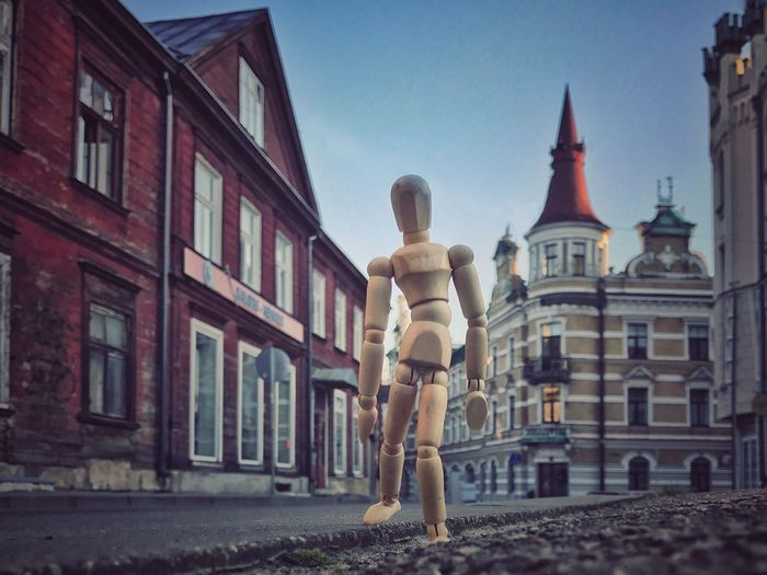 Walking streets of Riga Architecture Building Exterior Spirituality Built Structure Full Length Religion Outdoors Statue Sky Sculpture Day City Travel Destinations Woodyforest Creativity Riga Travel Latvia