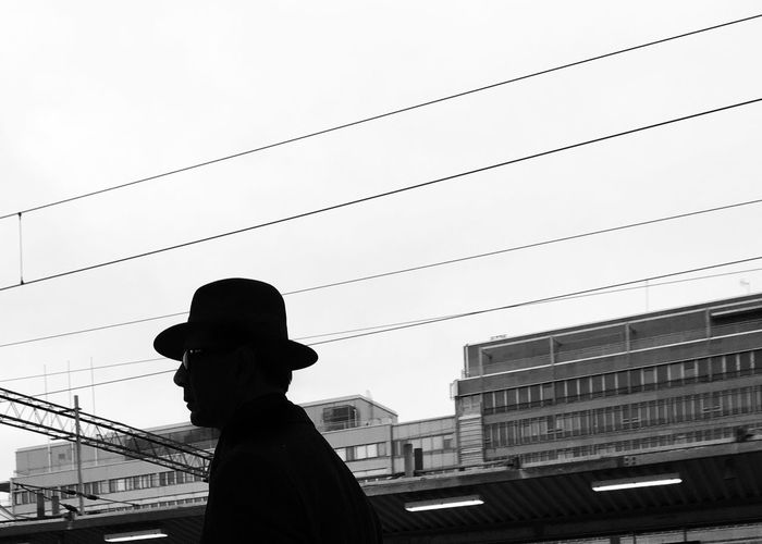 Sadness in your eyes Urbanphotography Hat Streetphotography Clear Sky Low Angle View Real People Silhouette Sky One Person Outdoors Day Building Exterior Architecture People