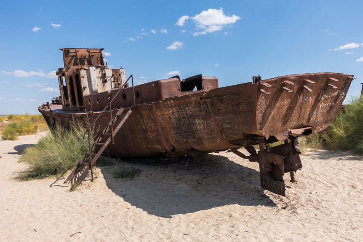 Rusted abandoned vessel in the ship cemetery of Aral Sea, Muynak, Uzbekistan Aral Sea Central Asia Karakalpakstan Uzbekistan Abandoned Beach Damaged Day Desolate Deterioration Nature Nautical Vessel No People Obsolete Outdoors Run-down Rusty Sand Sky Sunlight Transportation