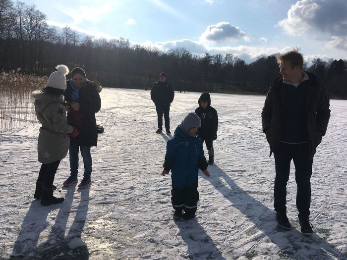 Snowy day. Walking and playing on frozen lake. Men Childhood Tree Plant Girls Cold Temperature Day Leisure Activity Group Full Length Lifestyles Sunlight People Snow