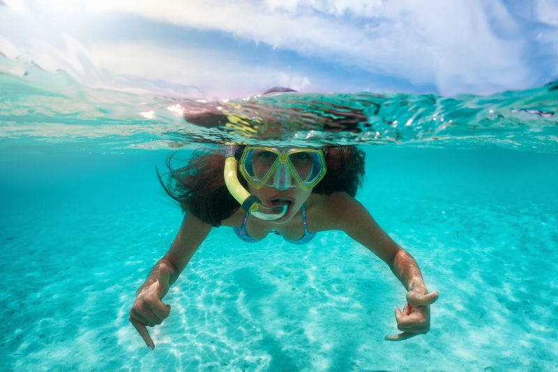 Portrait of young woman snorkeling in sea