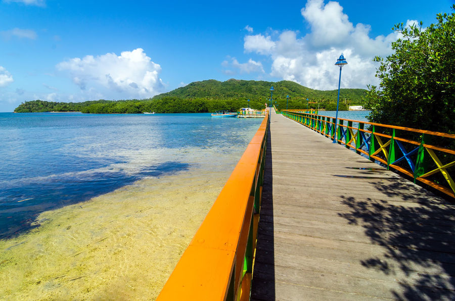 View of colorful bridge connecting two tropical islands Bay Beach Beautiful Calm Caribbean Coast Coastline Coconut Colombia Day Holiday Hot Idyllic Island Landscape Nature Ocean Outdoor Palm Providencia Resort Sand Scenery Scenic Turquoise