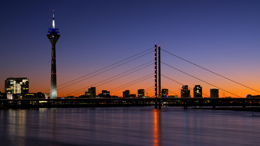 Colorful sunset on the rhine river with the cityscape of dusseldorf in the background, germany
