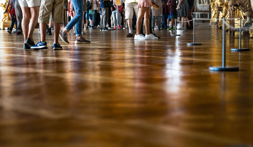 Visit Versailles. Reflections on floor The Traveler - 2018 EyeEm Awards Versailles Adult Body Part Child Crowd Flooring Group Group Of People Human Body Part Human Foot Human Leg Large Group Of People Low Section Reflection Sport Surface Level Teenager Waiting Women