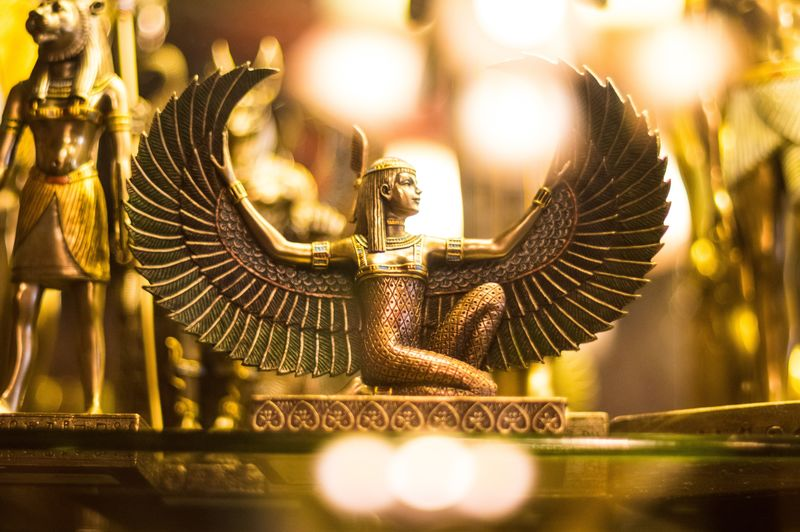Statue Gold Statue Book Store The Witchery Egyptian Egyptian Statue Art Sculpture Gold Bronze Bright Lights Bokeh Male Likeness Close-up Gold Colored Creativity Metal Ornate Angel Craft Human Representation Art And Craft No People Architecture Spirituality