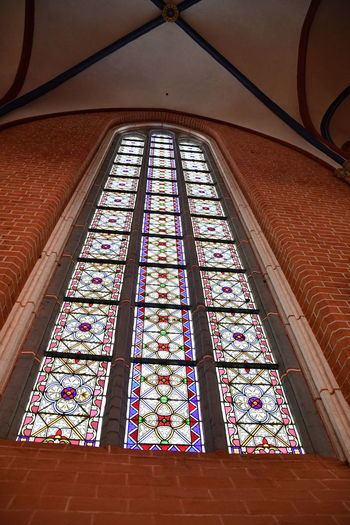 Münster Bad Doberan innen Münster Bad Doberan Innenansicht Kirchenschiff Stained Glass Glass - Material Low Angle View Glass Window Indoors  Architecture Built Structure Ceiling Building Religion No People Place Of Worship Spirituality Belief Multi Colored Pattern Day Arch Architecture And Art Ornate