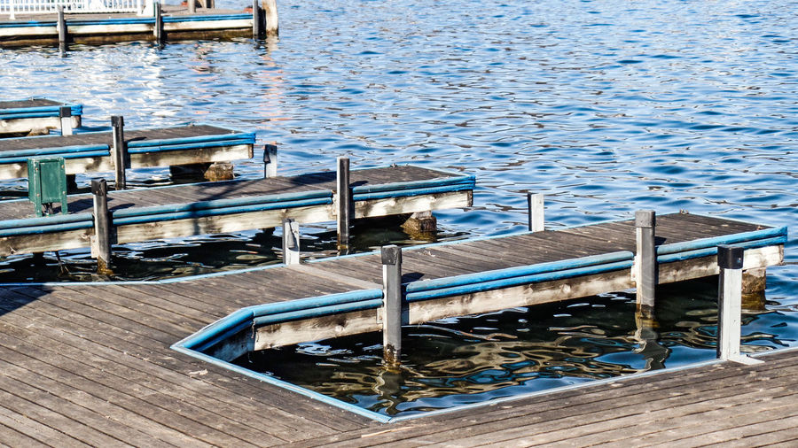 Water Seat Wood - Material No People Absence Empty Pier Nature Chair Day Blue Bench Outdoors High Angle View Lake Nautical Vessel Transportation Beauty In Nature Relaxation Wood